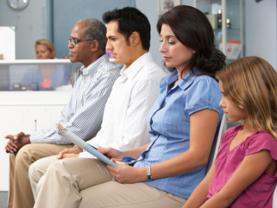 Image of patients waiting in a medical office lobby.